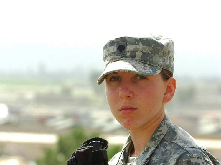 DOD handout photo of Army Spc. Monica Brown standing over Forward Operating Base Salerno in Khowst province