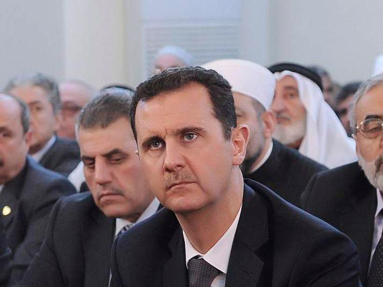 Syria's President Bashar al-Assad attends prayers during celebrations of Prophet Mohammed's Birthday, at the al-Afram mosque in Damascus