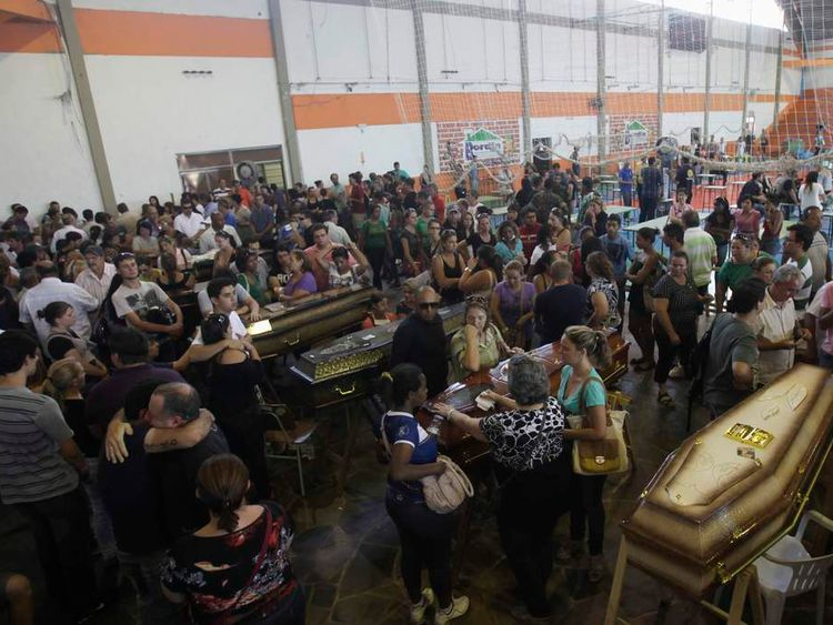 Relatives of the victims attend a collective wake in Santa Maria