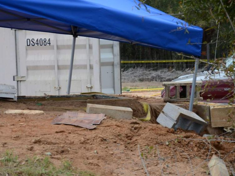 Handout of a tent covers the bunker where the five-year-old boy, known as Ethan, was rescued by law enforcement near Midland City