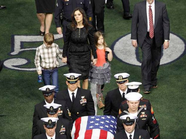 Taya Kyle and her children walk behind the coffin of her slain husband former Navy SEAL Chris Kyle during a memorial service for the former sniper at Cowboys Stadium in Arlington
