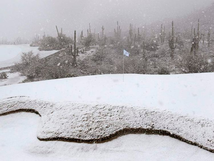 The 18th green is covered in snow as play was suspended during the first round of the WGC-Accenture Match Play Championship golf tournament in Marana