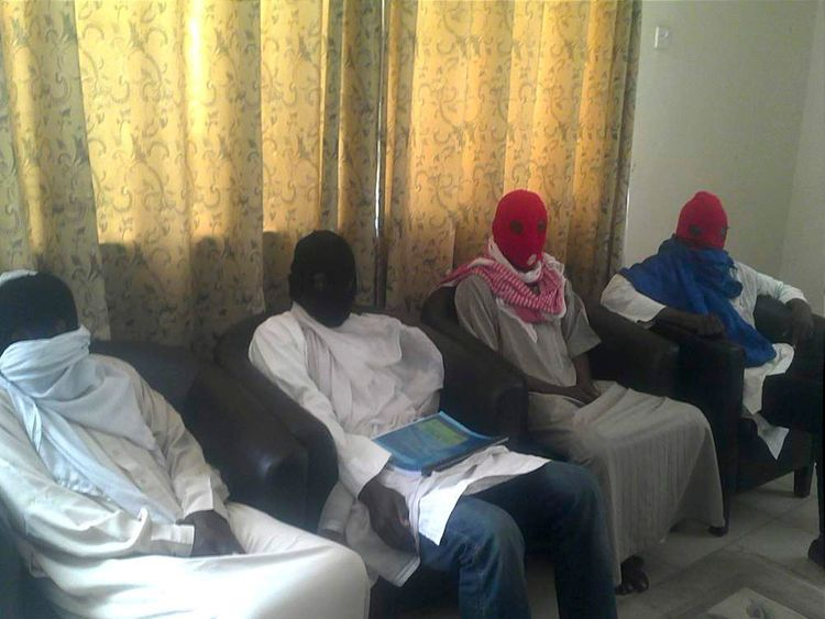 Members of Boko Haram splinter group attend a media conference in Maiduguri