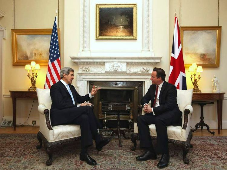 Britain's Prime David Cameron speaks with U.S. Secretary of State John Kerry at Number 10 Downing Street in London