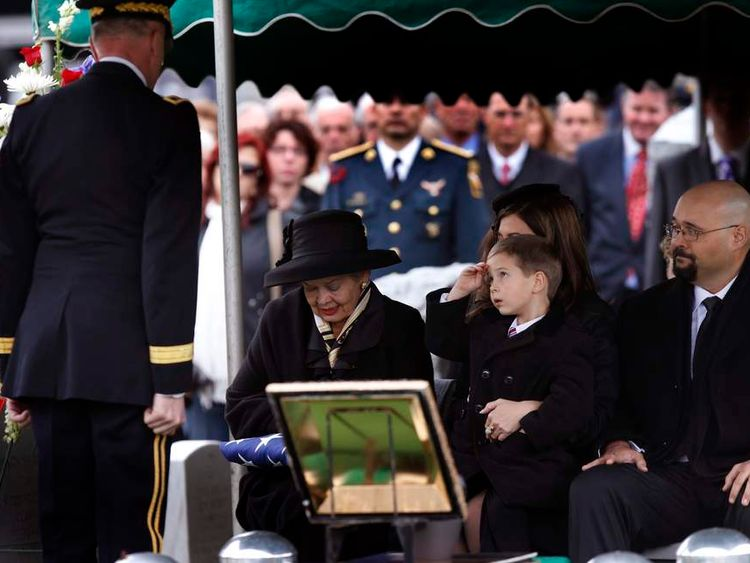 Max Schwarzkopf salutes Lt. Gen. David H. Huntoon, Jr as Schwarzkophf's widow Brenda received an American flag at the burial service for her husband at West Point