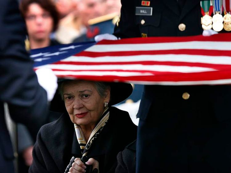 Brenda Schwarzkopf, widow of the late U.S. Four Star General H. Norman Schwarzkopf looks on as an American flag is folded over his grave during his burial service at the United States Military Academy at West Point