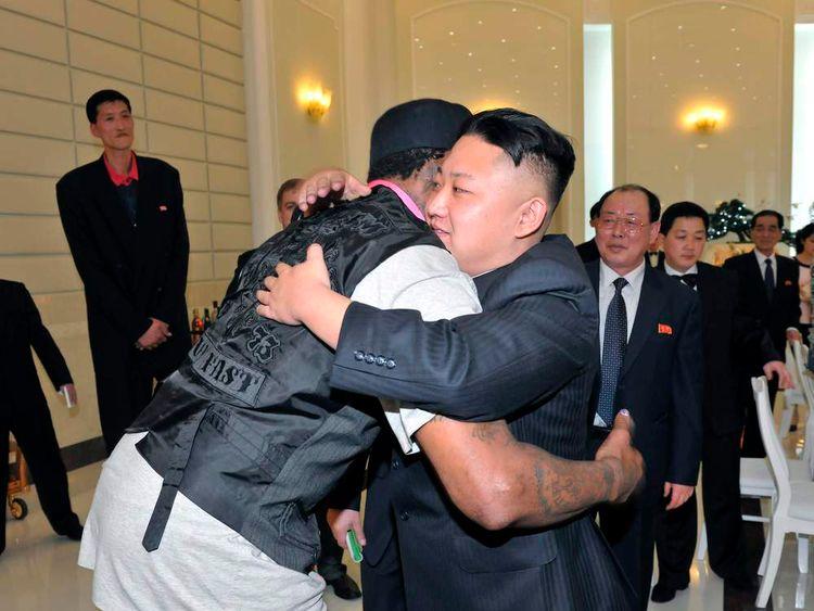 North Korean leader Kim Jong Un and former NBA basketball player Dennis Rodman hug in Pyongyang