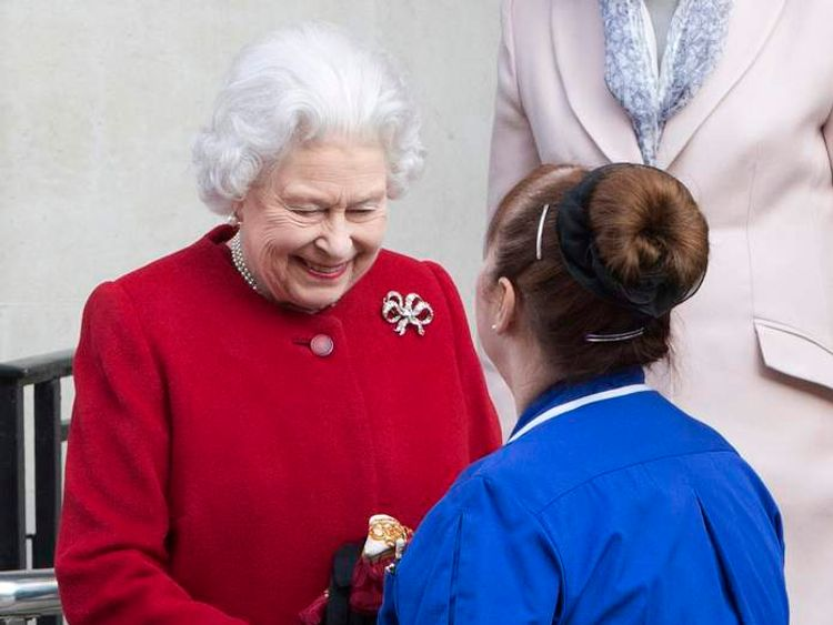 Britain's Queen Elizabeth shakes hands with nurse Anne Jenkins as she leaves King Edward VII hospital, in central London
