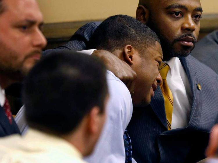Defense attorney Walter Madison (R) comforts Ma'lik Richmond (L) as Richmond reacts to the verdict during his trial at the juvenile court in Steubenville, Ohio March 17, 2013. Two high school football players from Ohio, Trent Mays, 17, and Richmond, 16, were found guilty of raping a 16-year-old girl at a party last summer while she was in a drunken stupor in a case that gained national exposure through social media. REUTERS/Keith Srakocic/Pool (UNITED STATES - Tags: CRIME LAW)