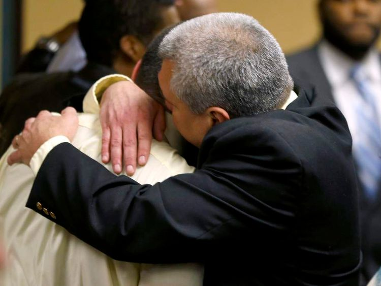 Brian Mays (R), hugs his son, Trent, after hearing the verdict in juvenile court in Steubenville, Ohio, March 17, 2013. Mays, 17, and Ma'lik Richmond, 16, were found guilty of raping a drunk classmate as she lay naked on a basement floor, too drunk to move or speak. REUTERS/Keith Srakocic/Pool (UNITED STATES - Tags: CRIME LAW EDUCATION SPORT SOCIETY)