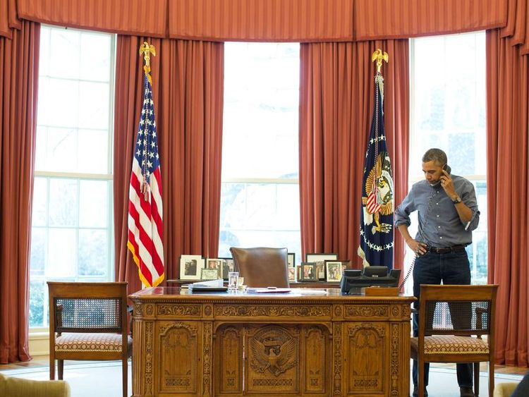 President Barack Obama talks on the phone in the Oval Office with Russian President Vladimir Putin about the situation in Ukraine
