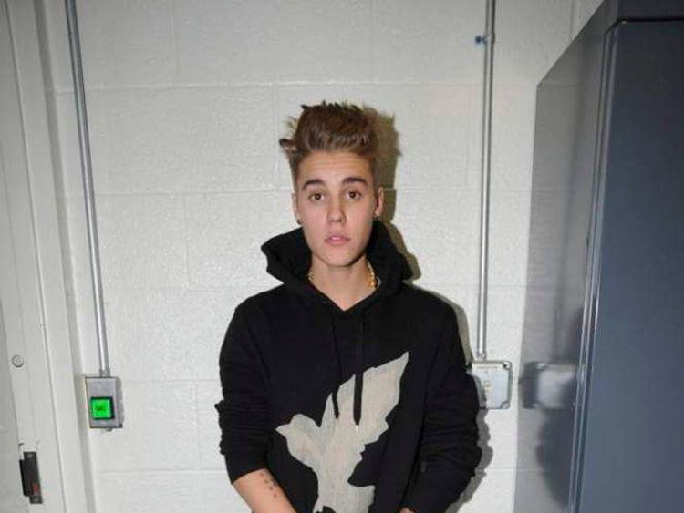 Handout shows Canadian pop singer Justin Bieber in police custody in Miami Beach, Florida