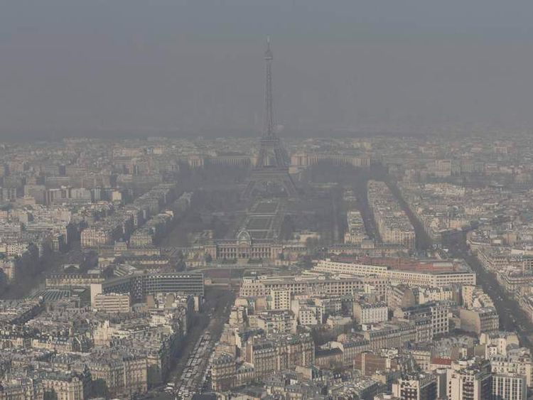 The Eiffel tower and the Paris skyline through a small-particle haze resulting in a high level air pollution