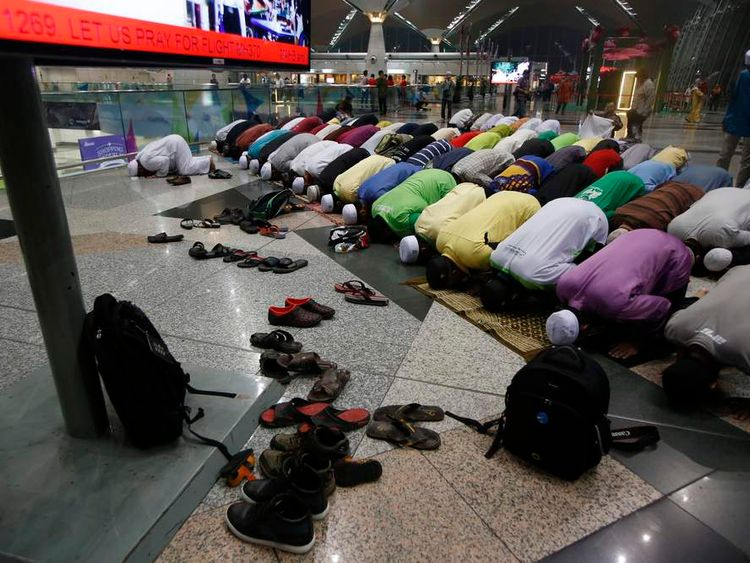 Muslims perform a special prayer for passengers of the missing Malaysia Airlines MH370 plane at Kuala Lumpur International Airport