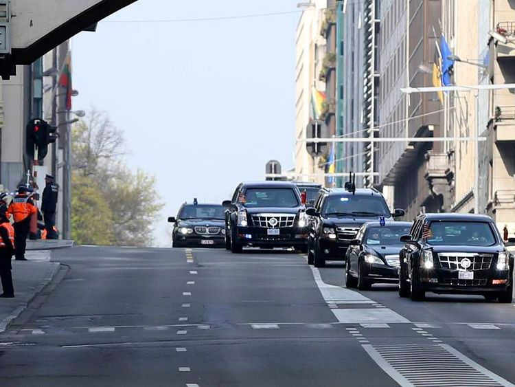 Belgian police officers stand guard as the motorcade carrying U.S. President Obama drives to Zaventem international airport in Brussels