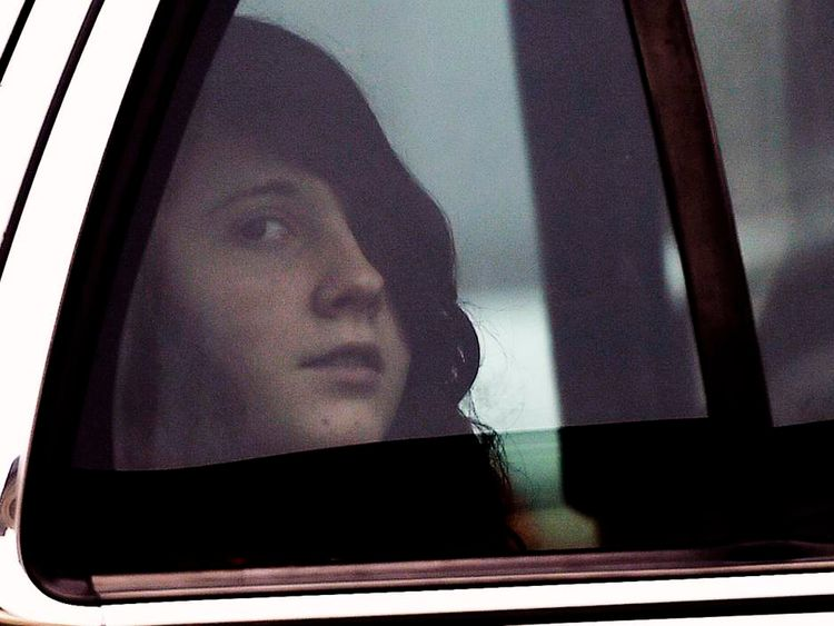 Miranda Barbour looks out of the window from a sheriff's car after appearing in court in Sunbury, Pennsylvania