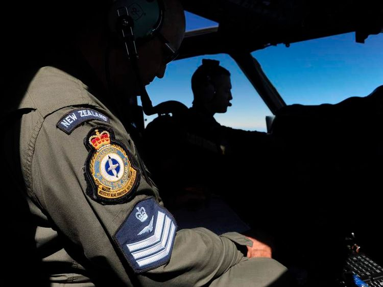 Pilot and captain Flight Lieutenant McAlevey, and flight engineer Poole look from the cockpit of a RNZAF P-3K2 Orion aircraft during the search over the southern Indian Ocean for missing flight MH370.
