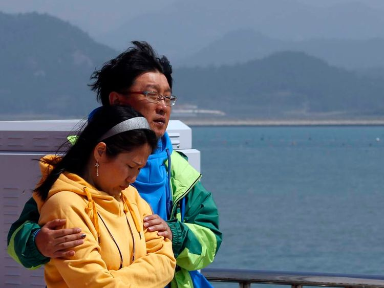 Family members of a missing passenger onboard the capsized Sewol ferry, react as they wait for news from the search and rescue team at a port in Jindo