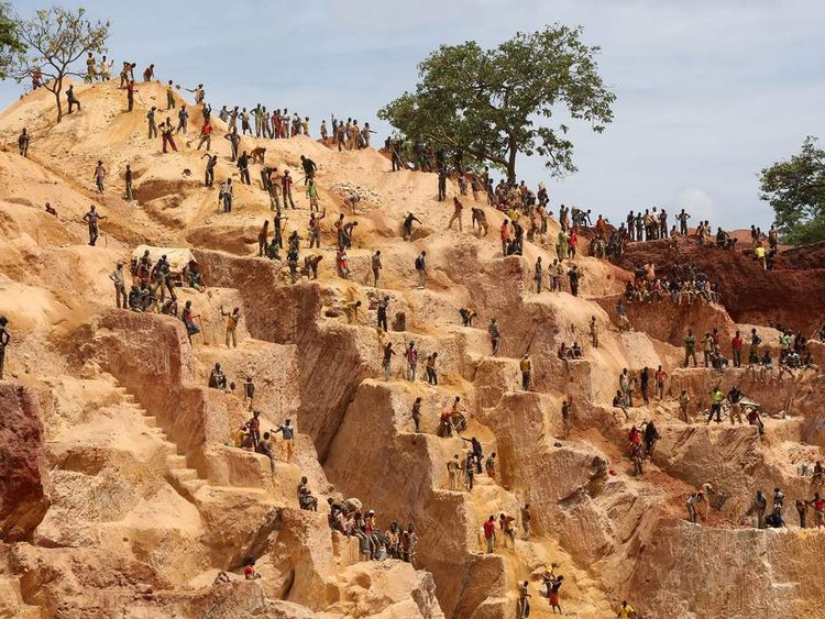 Prospectors work at the open-pit Djoubissi gold mine in Central African Republic