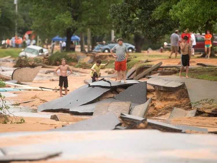 Residents survey flood damage to the Cordova Park neighborhood in Pensacola, Florida