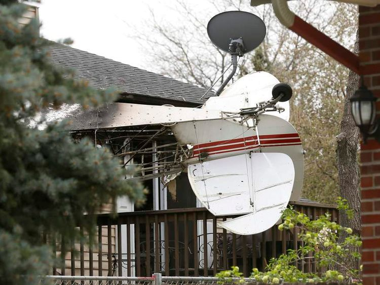 Tail section of a small plane is seen after it crashed into a house in Northglenn
