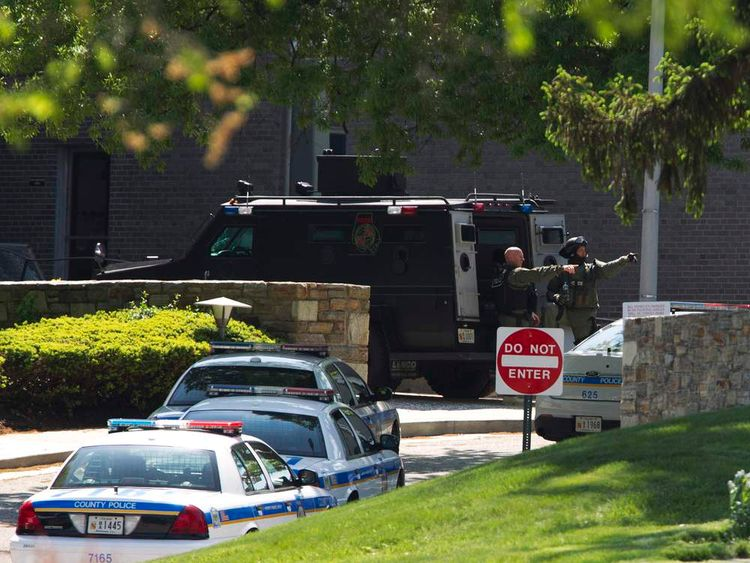 Members of the SWAT team step off their vehicle at ABC 2 news station in Towson, Maryland