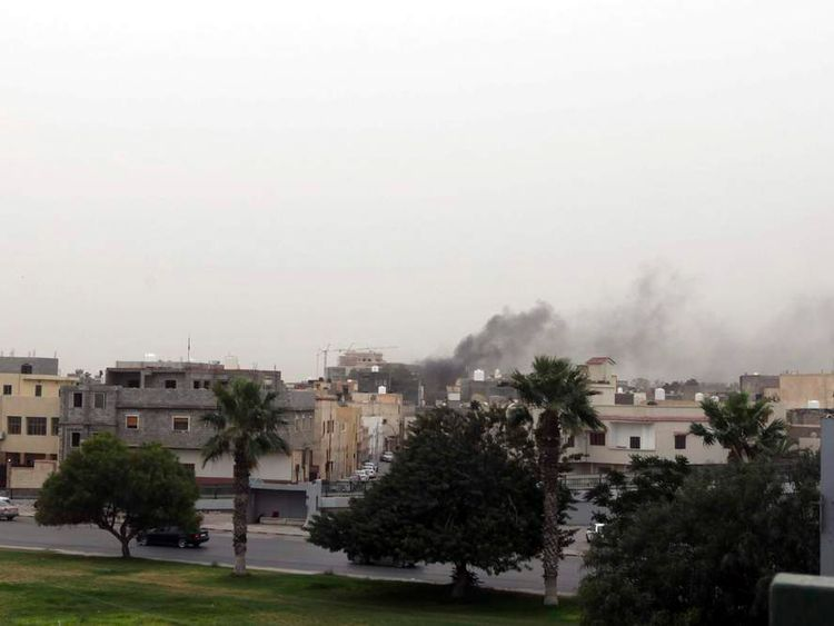 Smoke rises over the General National Congress building in Tripoli.