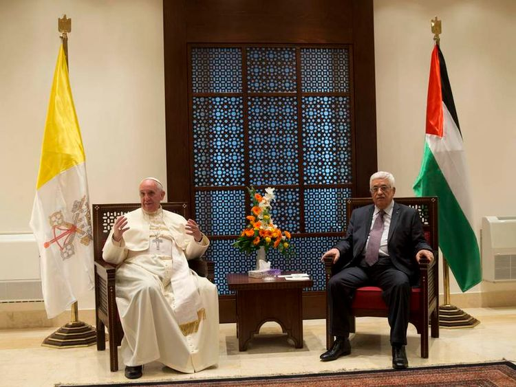 Pope Francis gestures during a meeting with Palestinian president Mahmoud Abbas in the West Bank town of Bethlehem