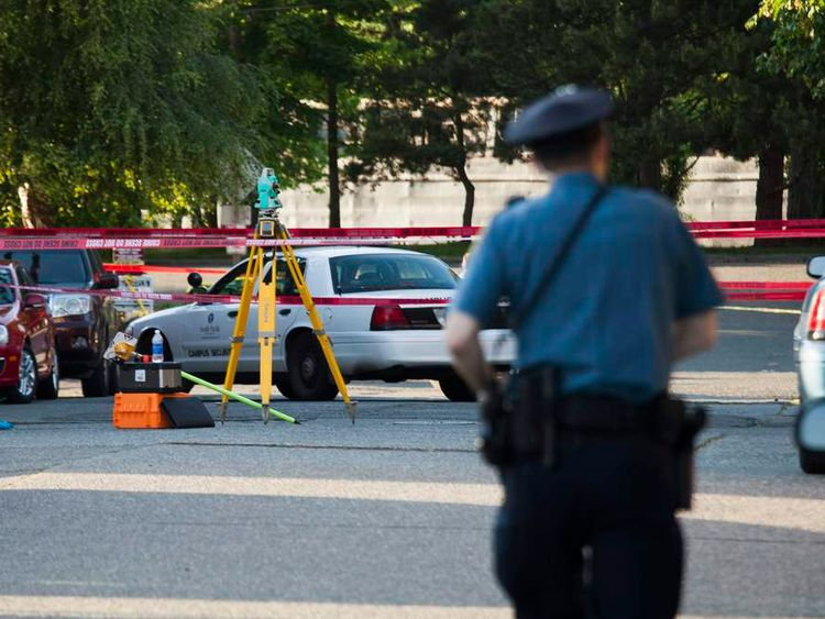 Police investigate the scene of a shooting on campus at Seattle Pacific University in Washington.