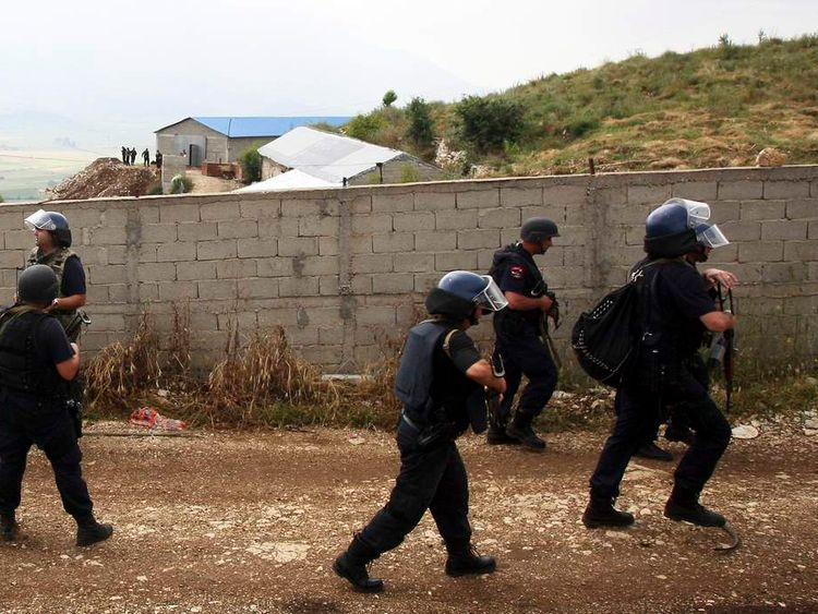 Members of the Albanian special police patrol in the village of Lazarat