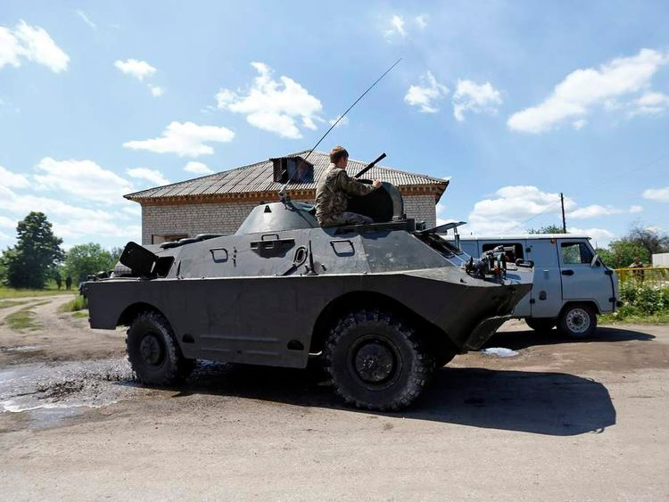 A pro-Russian separatist drives an armoured vehicle in Seversk
