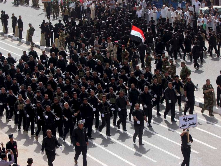 Mehdi Army fighters loyal to Shi'ite cleric Moqtada al Sadr march during a parade in Najaf