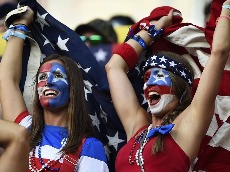 Fans of the US cheer before their 2014 World Cup Group G match against Portugal at the Amazonia arena in Manaus