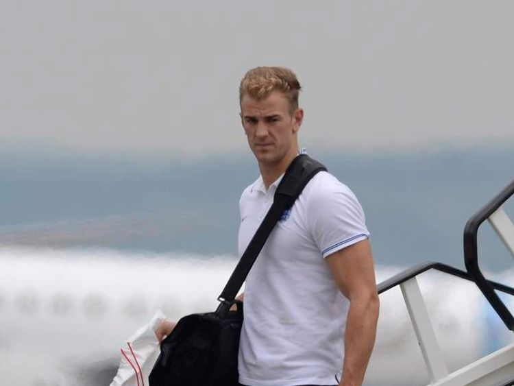 England's Hart arrives back from the 2014 World Cup in Brazil at Manchester airport
