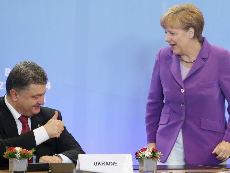 Petro Poroshenko signs a trade pact with the EU.