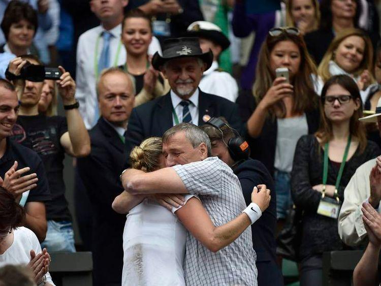 Petra Kvitova of the Czech Republic embraces her father