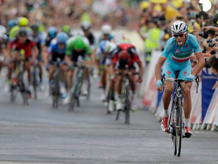 Astana team rider Nibali of Italy celebrates as he crosses the finish line to win  the second 201 km stage of  the Tour de France cycling race
