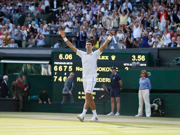 Novak Djokovic of Serbia celebrates after defeating Roger Federer of Switzerland in their men's singles finals tennis match on Centre Court at the Wimbledon Tennis Championships in London