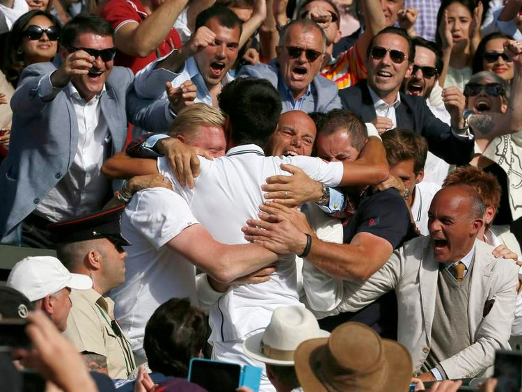 Novak Djokovic of Serbia celebrates with his coaching staff after defeating Roger Federer of Switzerland in their men's singles final tennis match at the Wimbledon Tennis Championships, in London