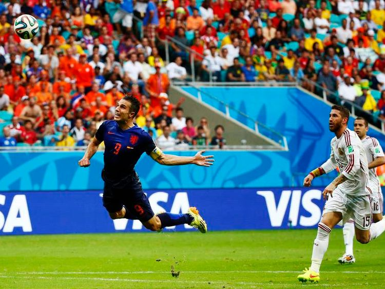 Robin van Persie of the Netherlands heads the ball to score against Spain during their 2014 World Cup Group B match at the Fonte Nova arena in Salvador.