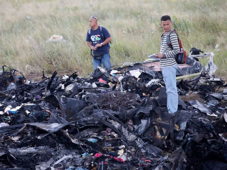 Malaysian air crash investigators inspect crash site of Malaysia Airlines Flight MH17, near the village of Hrabove (Grabovo), Donetsk