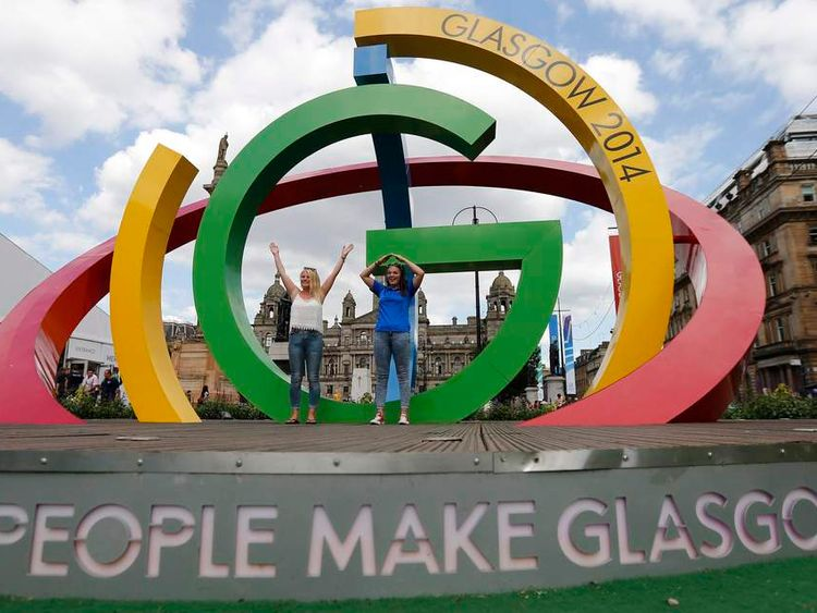 """Steer and MacLean pose on """"The Big G"""" 3-D structure at George Square in Glasgow, Scotland"""