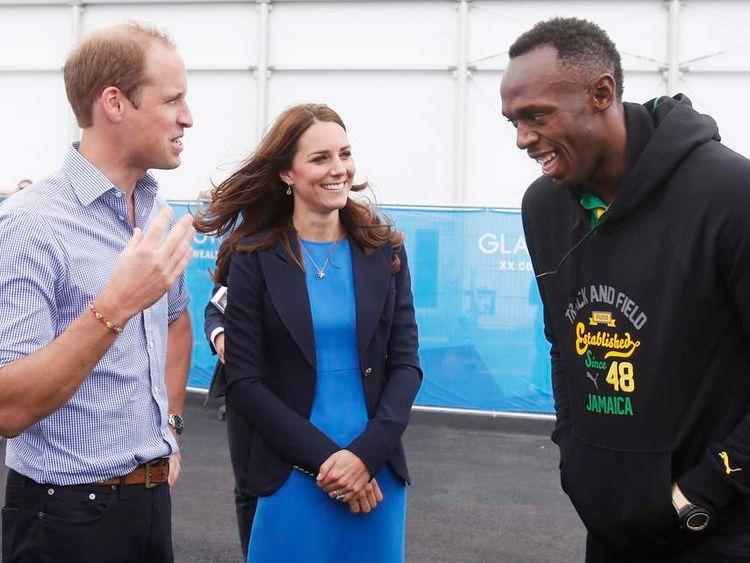 Prince William and Catherine, Duchess of Cambridge speak to Jamaica's Usain Bolt