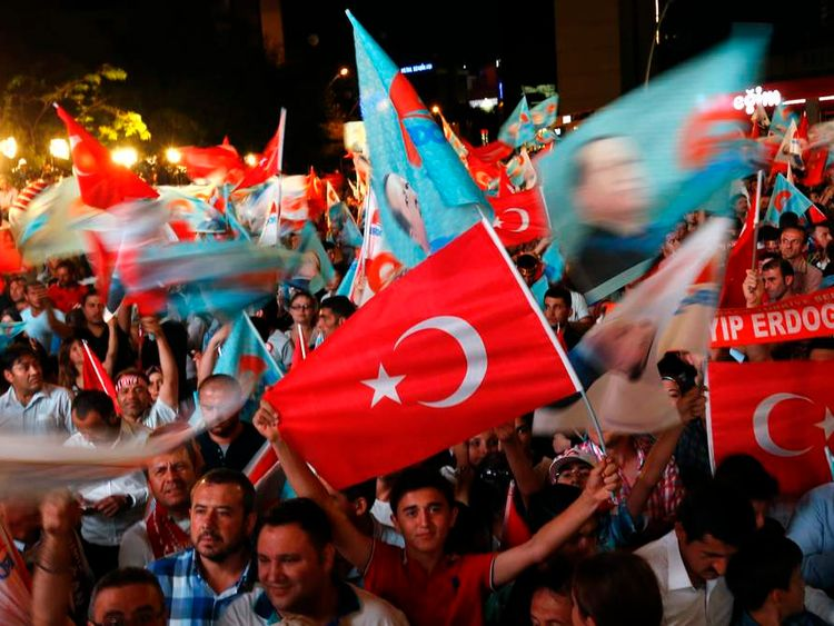 Supporters of Turkey's Prime Minister Erdogan celebrate his election victory in front of the party headquarters in Ankara