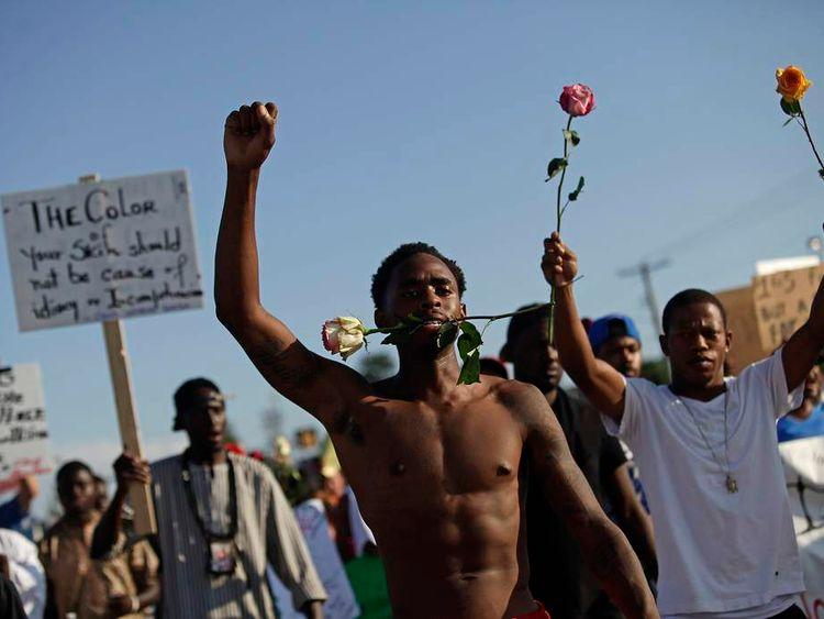 Demonstrators protest Michael Brown's murder in Ferguson