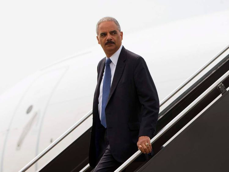 U.S. Attorney General Eric Holder arrives at Lambert?St. Louis International Airport
