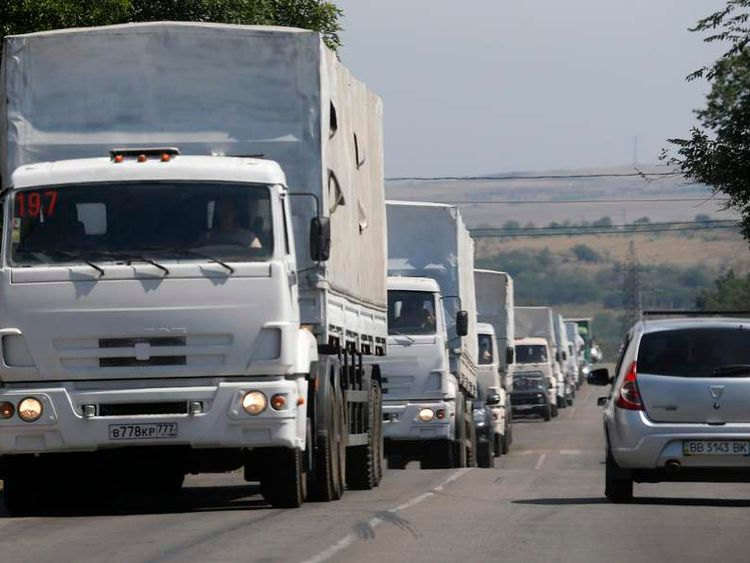 Trucks of a Russian convoy carrying humanitarian aid for Ukraine, drive in the direction of the Ukrainian border near the town of Donetsk, in Russia's Rostov Region