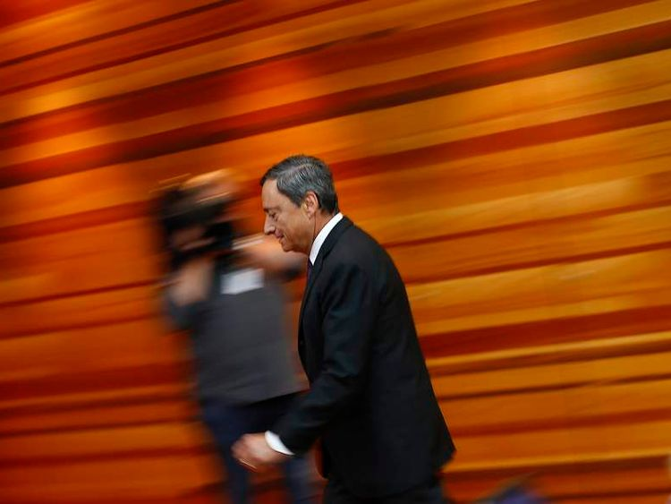 Draghi, President of the ECB arrives for the monthly news conference in Frankfurt