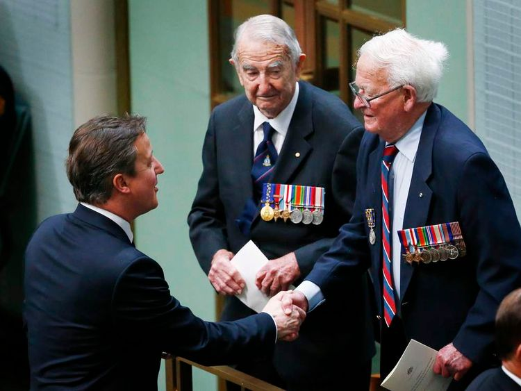 British PM Cameron shakes hands with Australian World War Two veteran Maxton in Australia's House of Representatives chamber at Parliament House in Canberra