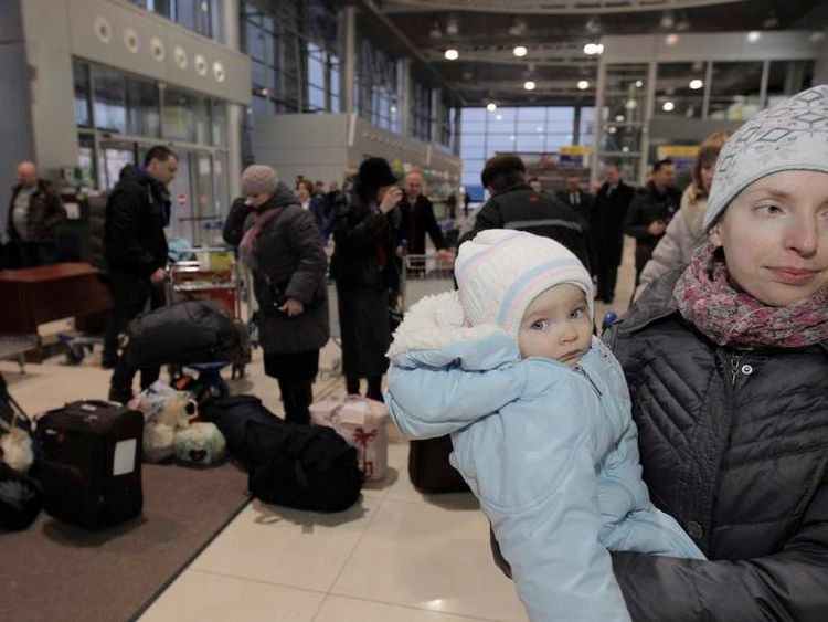Polish citizens evacuated from the eastern Ukrainian region of Donetsk, prepare to depart for Poland to escape the fighting between the Ukrainian army and pro-Russian rebels, at Kharkiv airport